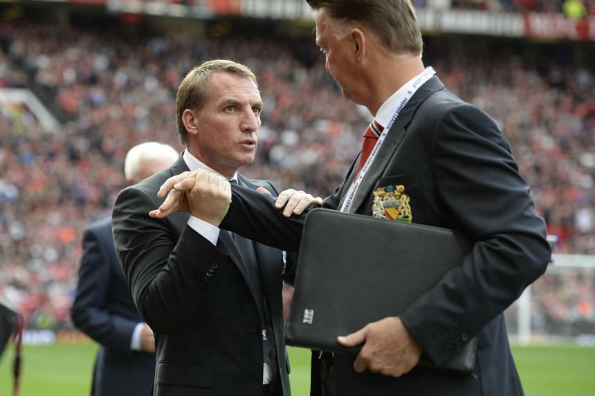 Rodgers (left) is greeted by Manchester United manager Louis van Gaal ahead of the match.