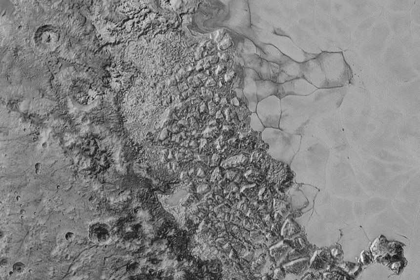 In the centre of this 470km-wide image is a large region of jumbled, broken terrain on the northwestern edge of the vast, icy plain informally called Sputnik Planum.