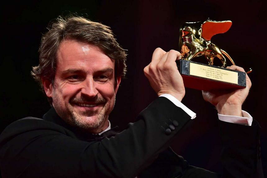 Director Lorenzo Vigas holds the Golden Lion for Best Film for his movie Desde Alla (From Afar).