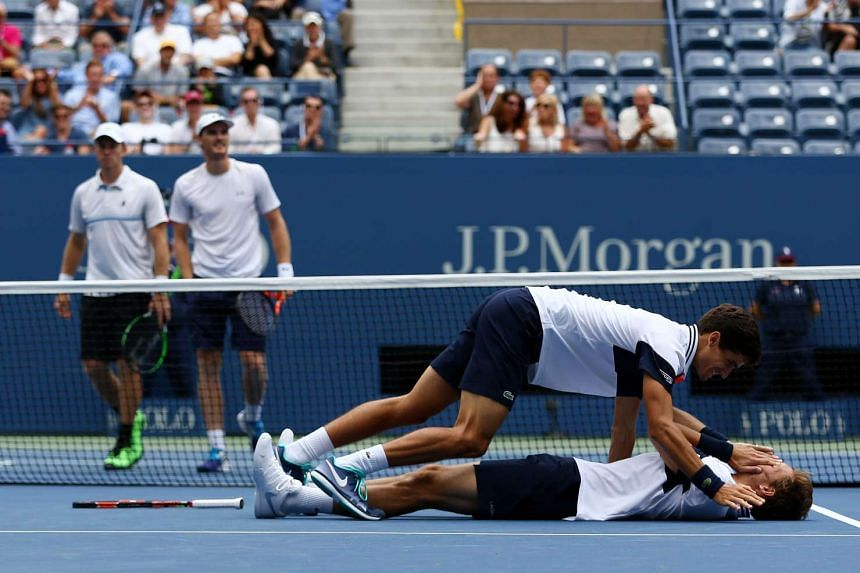 Herbert and Mahut of France celebrate after defeating Jamie Murray of Great Britain and John Peers of Australia.
