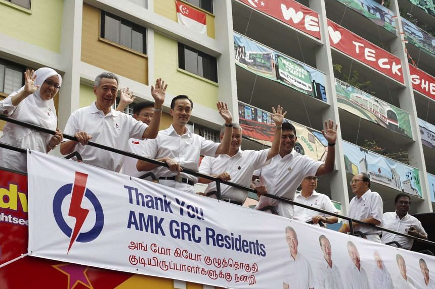Singapore's Prime Minister and Secretary-General of the People's Action Party (PAP) Lee Hsien Loong (second left) and his team thank supporters after the general election on Sept 12, 2015.