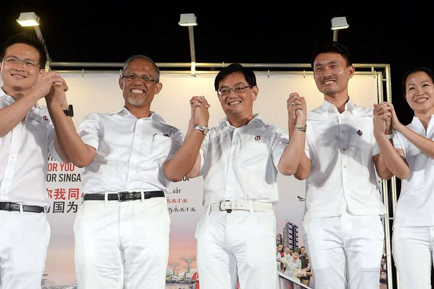 Education Minister Heng Swee Keat (centre) with his Tampines GRC teammates (from left) Desmond Choo, Masagos Zulkifli, Baey Yam Keng and Cheng Li Hui.