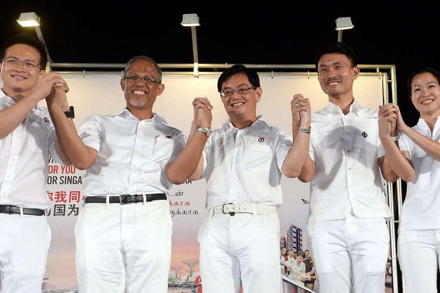Education Minister Heng Swee Keat (centre) with his Tampines GRC teammates (from left) Desmond Choo, Masagos Zulkifli, Baey Yam Keng and Cheng Li Hui.