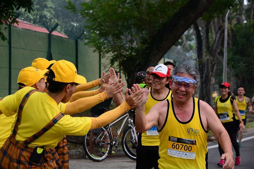 Runners being encouraged along the Yellow Ribbon Prison Run