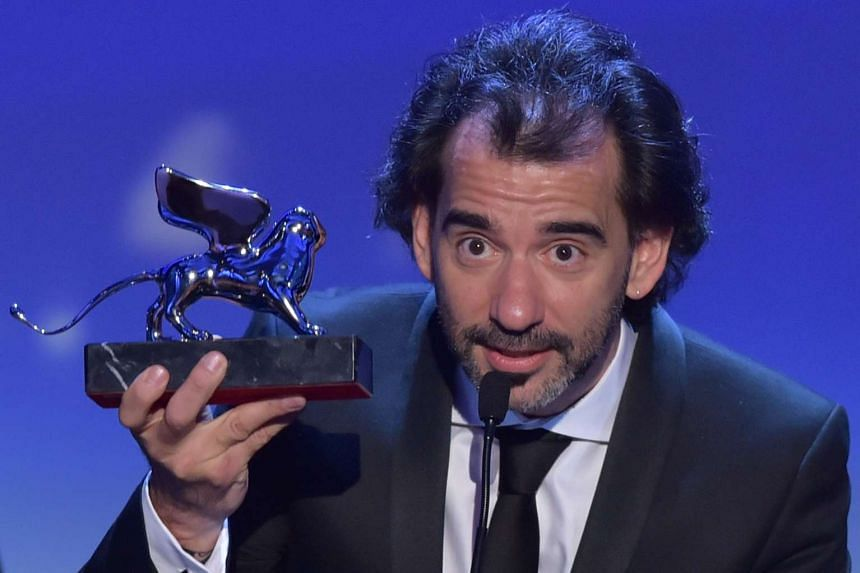 Director Pablo Trapero receives the Silver Lion for Best Director for his movie The Clan.