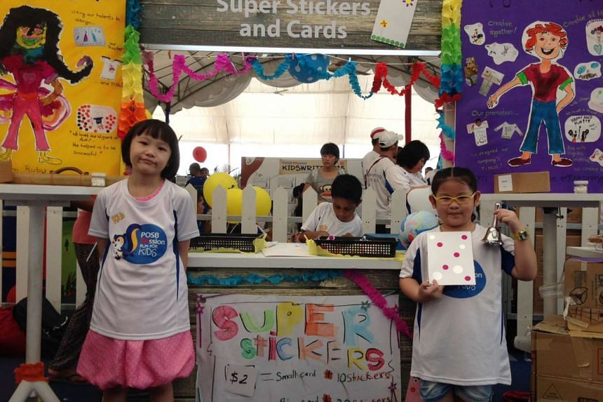 Chooi Pei Yee (left) and Seet Jiaxin, both 7, selling cards at their booth at the Kids' Bazaar at the Marina Bay Promontory on Sept 13, 2015.