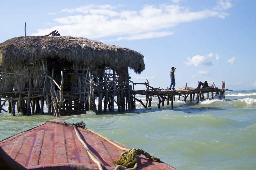 The Black River is home to about 300 crocodiles; Floyd's Pelican Bar (above) is built on stilts driven into a sandbank in the middle of the sea; and cliff-diving at the west end of Negril.