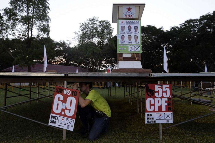 Party members and volunteers setting up the stage for a Singapore Democratic Alliance rally at Pasir Ris Park on Sept 5. The SDA team in Pasir Ris-Punggol GRC sought to tap sentiment against a population planning parameter of 6.9 million, and called