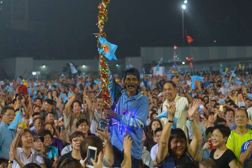 Workers' Party supporters in high spirits during the Aljunied GRC rally at the Serangoon Stadium on Sept 8.