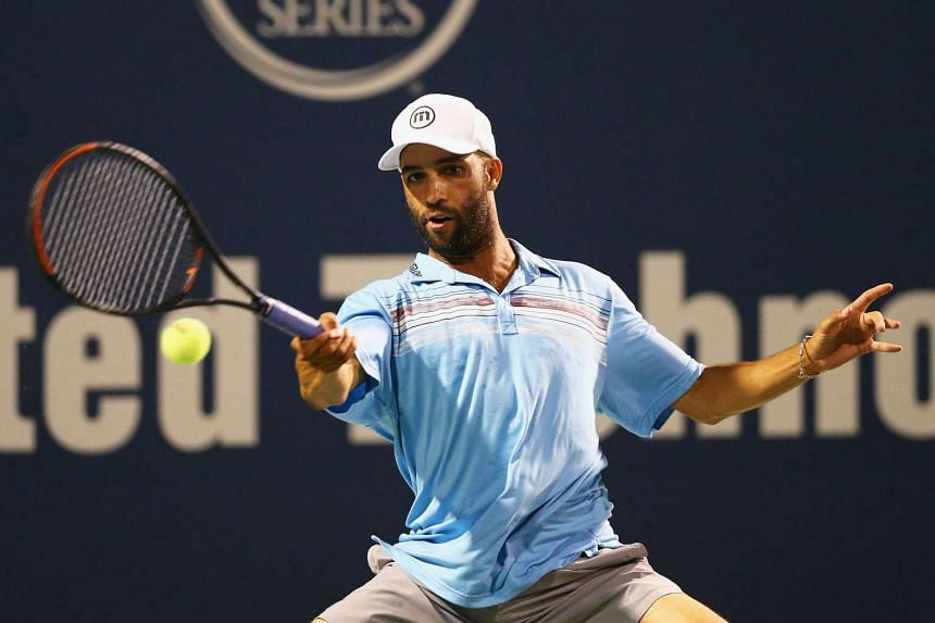 Retired professional tennis player James Blake (above) was mistaken for a suspect in a fraud case. In the video, officer James Frascatore is seen wrapping an arm around Mr Blake's neck and throwing him onto the sidewalk.