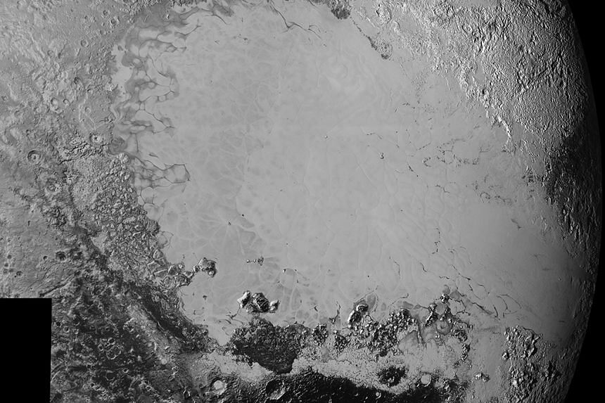 A mosaic of high-resolution images of Pluto, sent back from Sept 5 to 7, 2015.