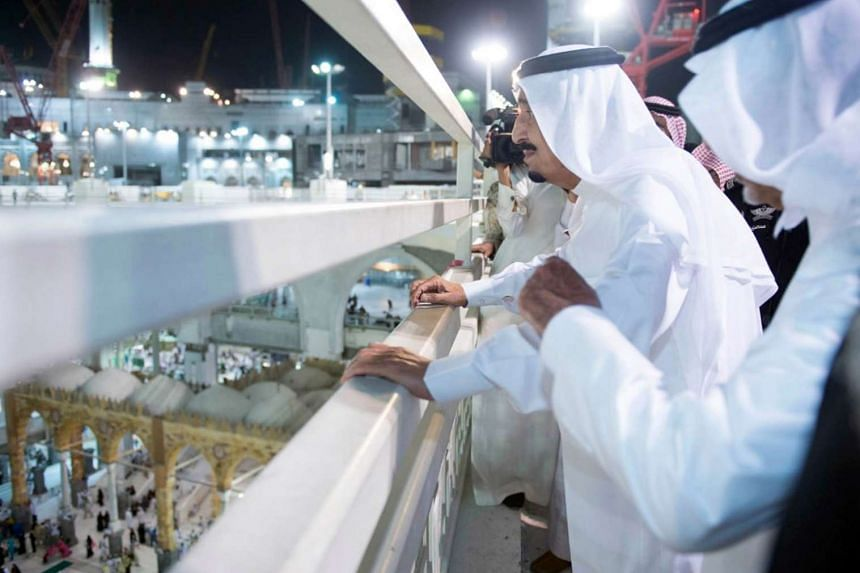 Saudi King Salman bin Abdulaziz (second right) looks at pilgrims during a tour of the site where a crane fell inside the Grand Mosque.