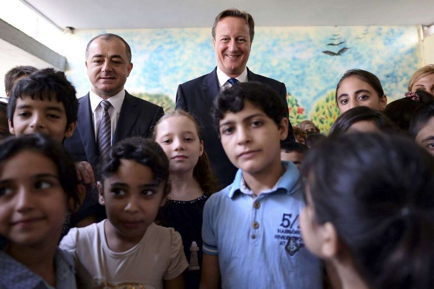 British Prime Minister David Cameron visits the Sed El Boucrieh School with Lebanese Education Minister Elias Bou Saab, in Beirut, Lebanon, on Sept 14, 2015.