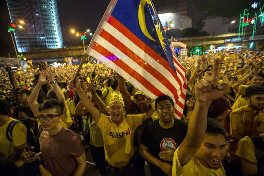 "Supporters of pro-democracy group ""Bersih"" (Clean) shout slogans during a rally near Dataran Merdeka in Malaysia's capital city of Kuala Lumpur, Malaysia, Aug 30, 2015."