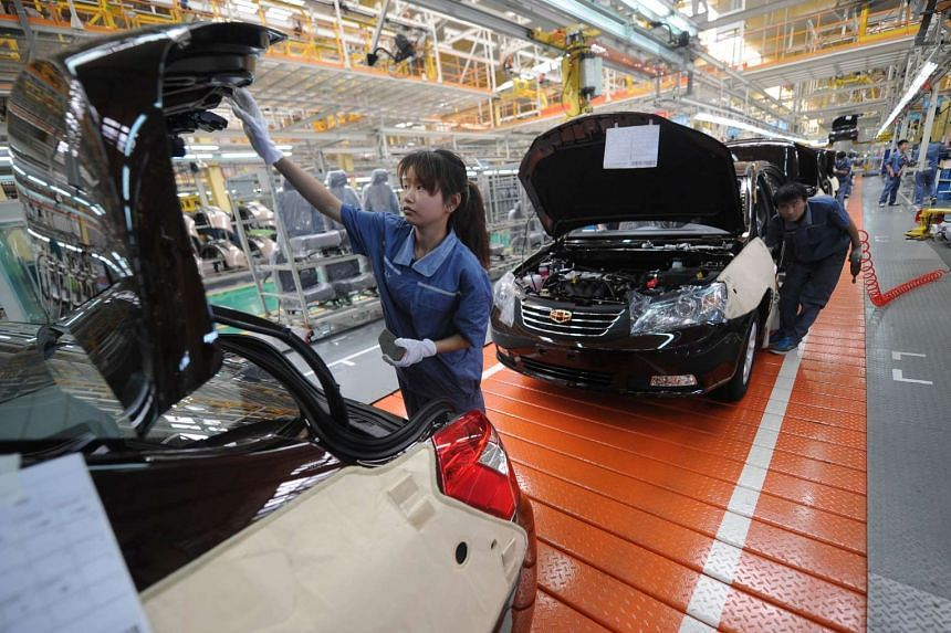 Workers building a car on the Geely Motors assembly line in Cixi, China's Zhejiang province.