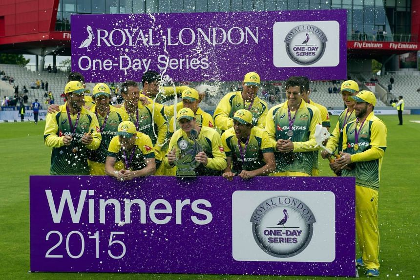 Australia's players celebrate by spraying champagne as they stand with the one-day series trophy after winning the fifth one day international (ODI) cricket match between England and Australia.