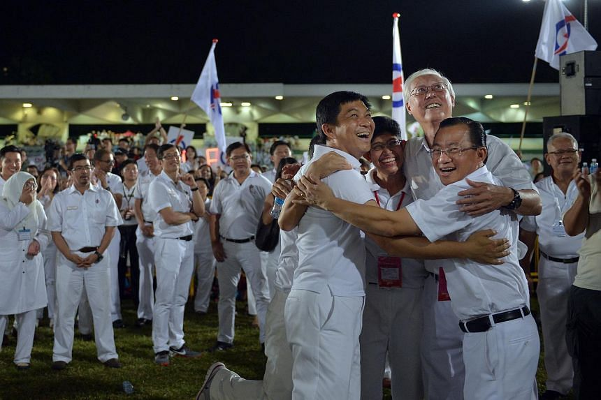 (From left) Tan Chuan-Jin, Edwin Tong (hidden), Dr Fatimah Lateef, Goh Chok Tong and Seah Kian Peng from the People's Action Party (PAP) hugging after hearing the results for Marine Parade GRC.