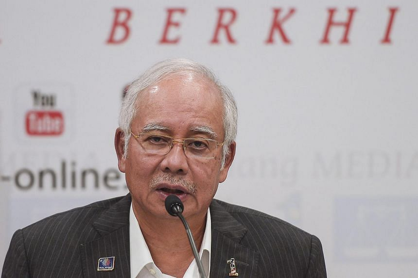 Malaysian Prime Minister Najib Razak speaks during a news conference after the United Malays National Organisation (UMNO) party's supreme council meeting.