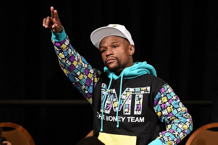 Floyd Mayweather Jr. walks in to his post-fight news conference at the MGM Grand Hotel & Casino.
