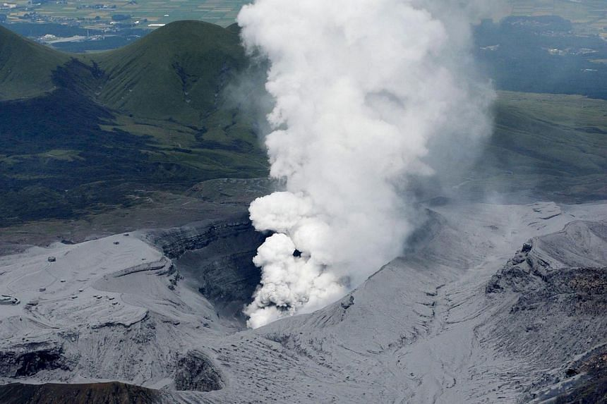 An aerial view shows an eruption of Mount Aso in Aso, Kumamoto prefecture, southwestern Japan, in this photograph taken by Kyodo on Sept 14, 2015.