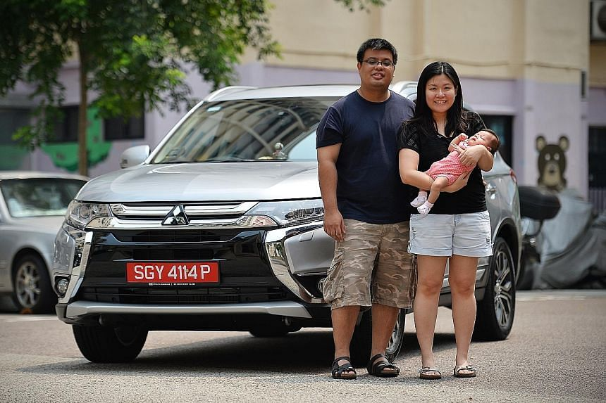 Off-peak car owner Jeosiah Wee, with his wife Clarissa and their child. He says the car is mainly for weekends and taking the family out.