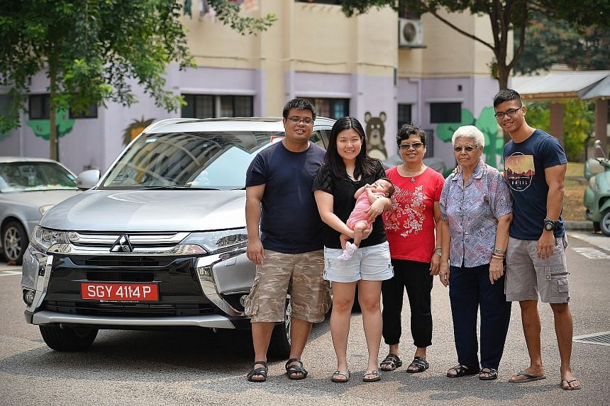 Off-peak car owner Jeosiah Wee (far left) with his family. Mr Wee uses his car on weekends and for taking his family out.