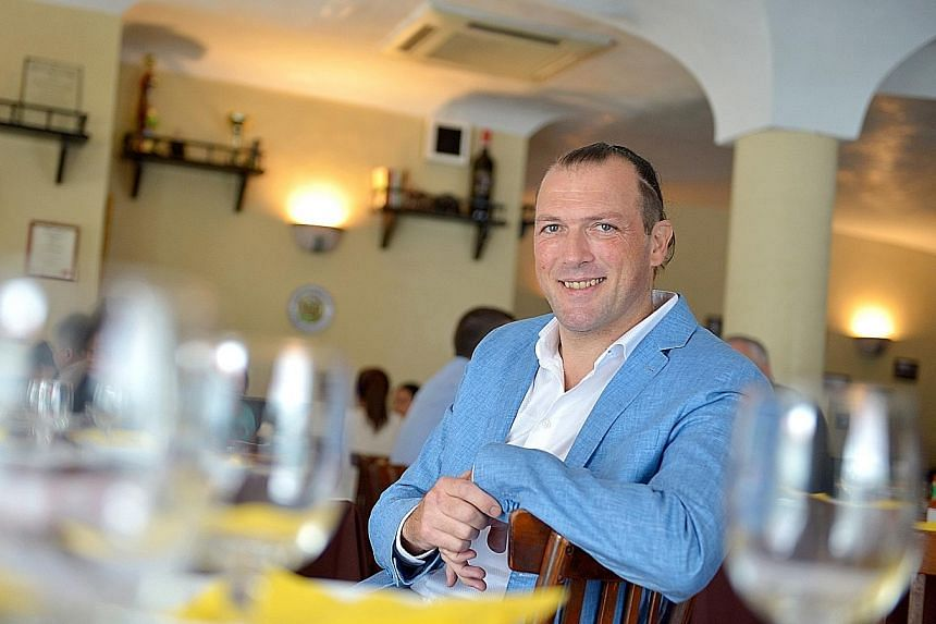 Al Forno's chef and owner Alessandro Di Prisco (above) says he grew up enjoying daily home-cooked meals which were elaborate affairs.