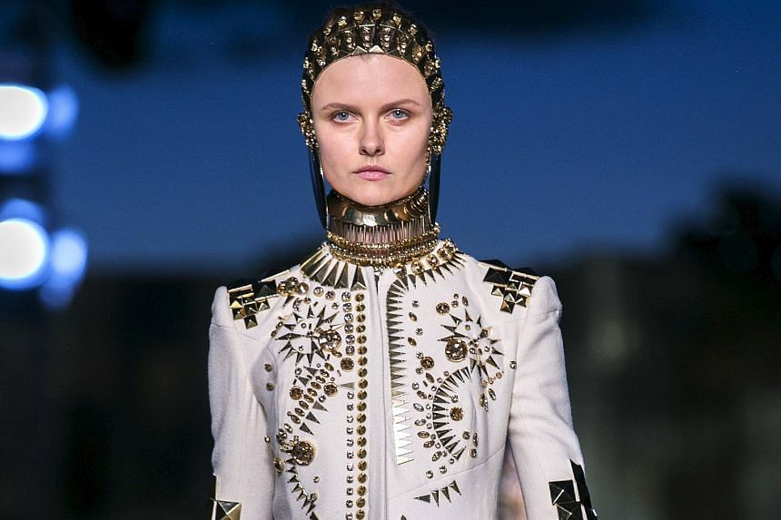 While the palette was mostly white and black (above), the outfits designed by Givenchy's Riccardo Tisci had a sensual theme.