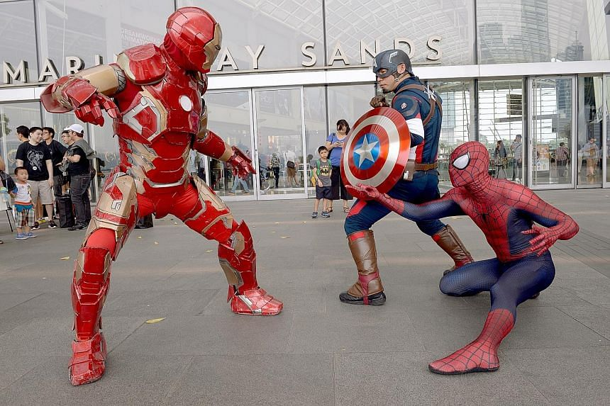 East and West: Iron Man (above, left) battles Captain America (centre) and Spiderman (right).