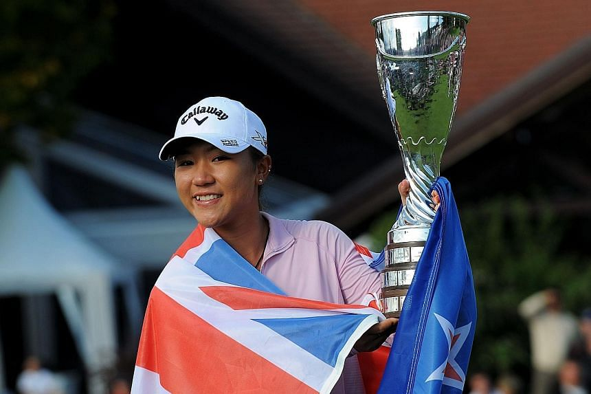 Lydia Ko with her trophy after winning the year's final Major, the Evian Championship, yesterday. The 18-year-old is 171 days younger than Morgan Pressel was when she won the 2007 Kraft Nabisco Championship.