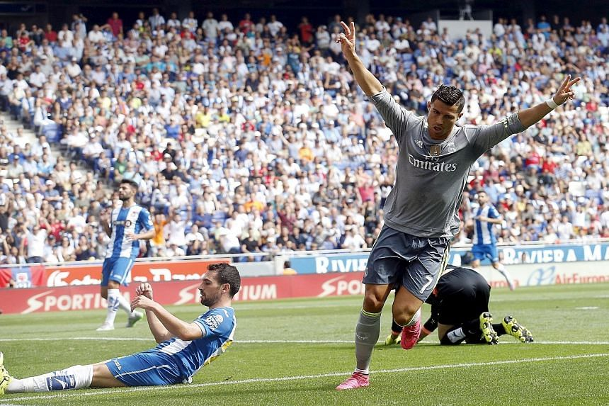 Real Madrid star Cristiano Ronaldo scored five times against Espanyol to become his club's record scorer in Spain's top flight with 230 goals in just 203 league games.
