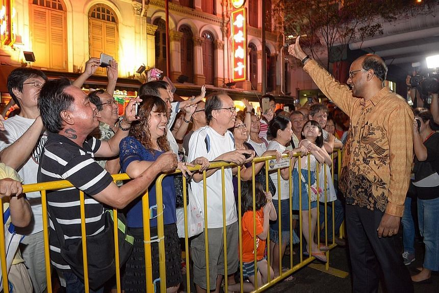 Mr Tharman greeting the crowd at the launch of the Mid-Autumn Festival celebrations in Chinatown yesterday. He said Singapore must remain a society with diverse voices, not just during the elections.