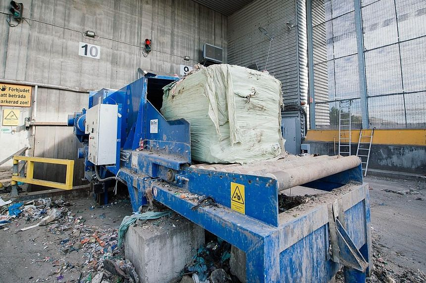Imported waste from Scotland being crushed in Sweden before being burnt to create heat and energy. The country powers its homes with garbage, but does not have enough as it sorts and recycles waste conscientiously.
