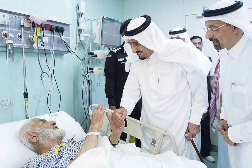 Saudi King Salman visiting one of the victims at a hospital in the Muslim holy city of Mecca on Saturday. The king also went to the site of the crane collapse at the Grand Mosque and promised a thorough investigation into the tragedy.