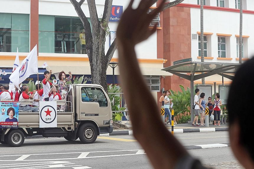 Mrs Lina Chiam and party members waving to residents in Potong Pasir from the SPP lorry, which also went around Sennett Estate before ending at Toa Payoh Lorong 8.