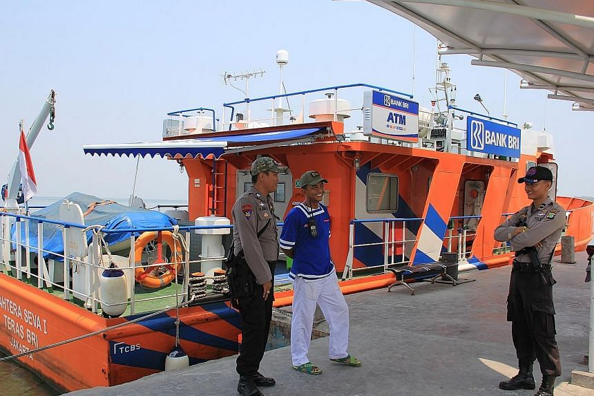 This floating bank, owned and operated by state-bank BRI, has an air-conditioned banking cabin staffed by up to four bank employees and an ATM; Madam Ningsih (above left) gets her banking done on the boat, saving her the bother of travelling from Unt