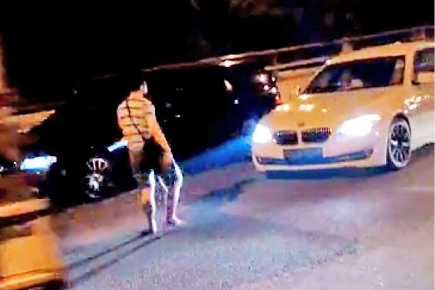 A woman stopped at least two cars on the Seletar Expressway at around 1.45am on Sept 13, 2015.