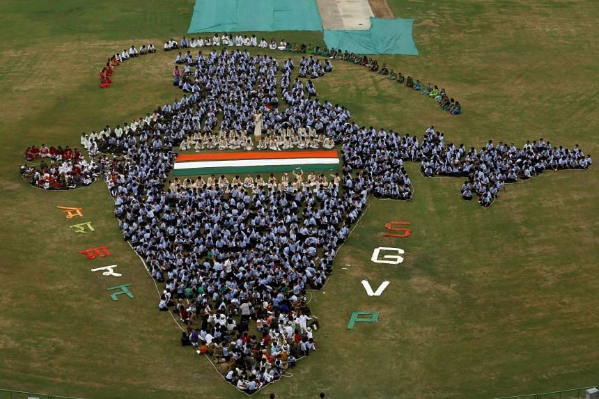 Students make a formation of a map of India inside the school premises last month in Ahmedabad city in Gujarat state. The state is India's best place for conducting business, the World Bank said on Monday, in a report that ranks the country's sta