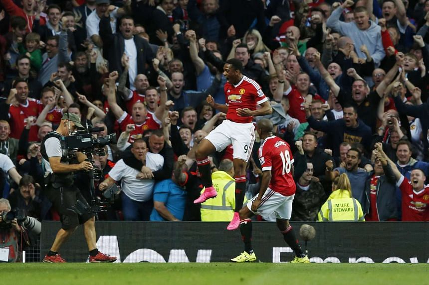 Anthony Martial celebrates after scoring the third goal for Manchester United.