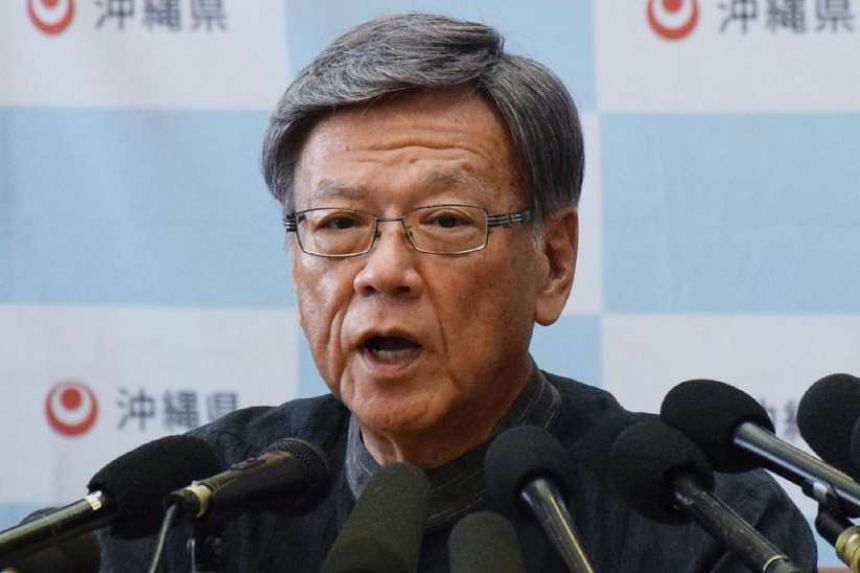 Okinawa Governor Takeshi Onaga announces he will revoke approval for work on a US base in the latest setback in a long-running dispute over the controversial plan at his prefectural office in Naha in Japan's southern island of Okinawa on Sept 14, 201
