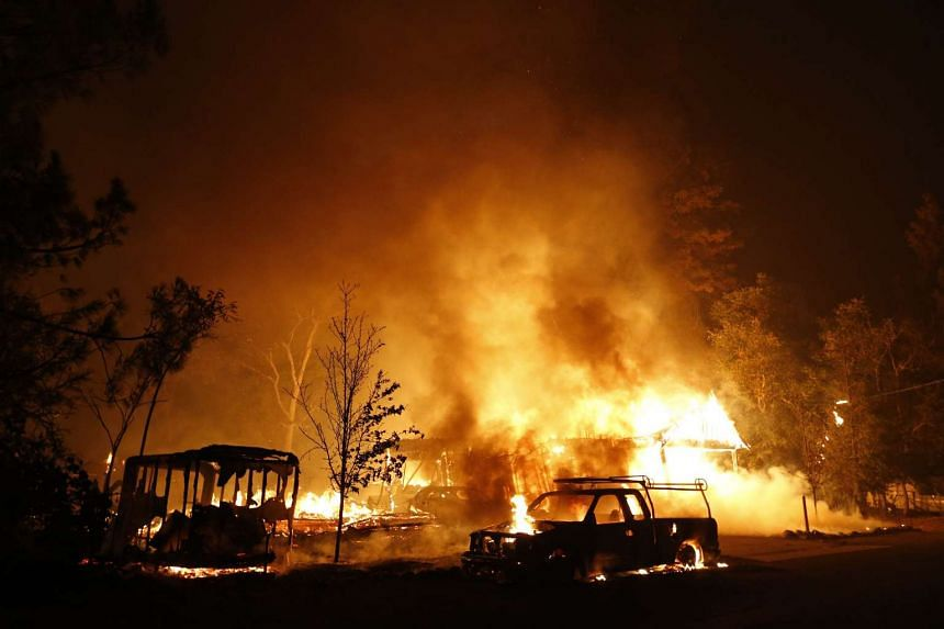A car and home burning on Sunday in Middletown, California. The town, which has a population of 1,300, is  particularly devastated by the Valley Fire, according to local daily Santa Rosa Press-Democrat.