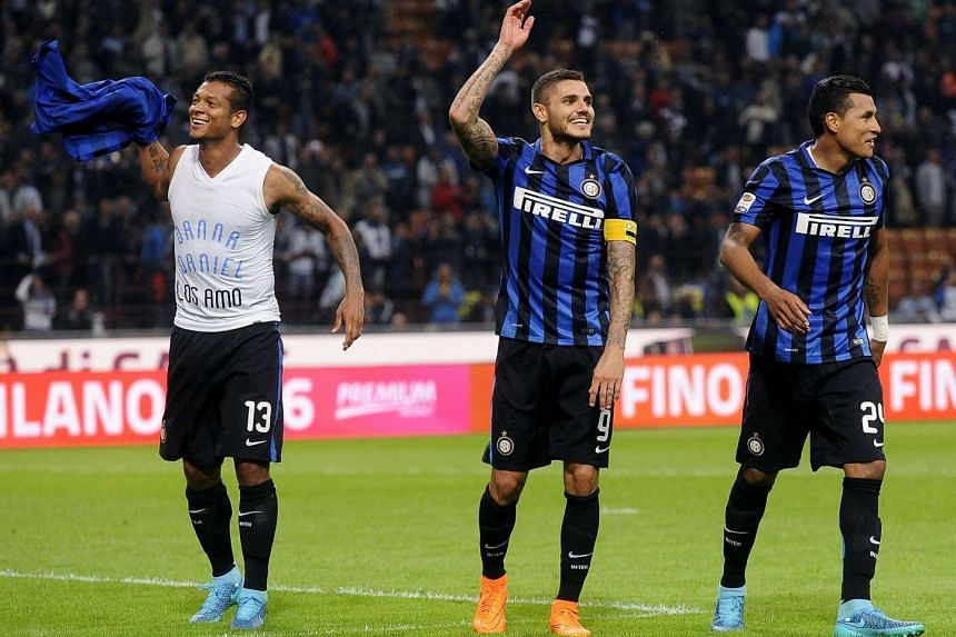 Inter Milan's Fredy Guarin (left), Mauro Icardi (centre) and Jeison Murillo (right) celebrate their victory over AC Milan at the end of their Italian Serie A soccer match at the San Siro stadium in Milan on Sunday.
