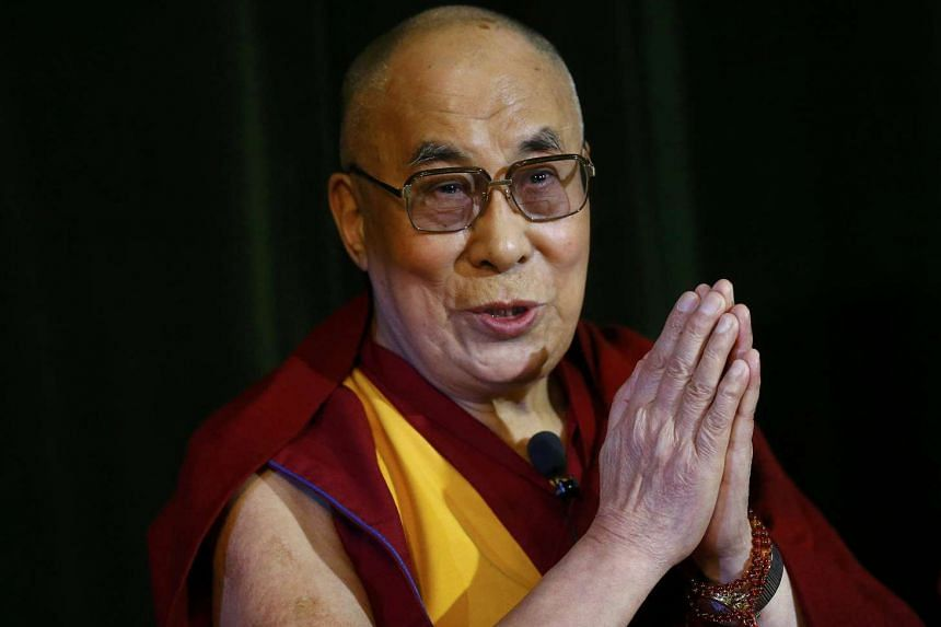 The Dalai Lama speaks during a news conference at Magdalene College in Oxford on Monday.