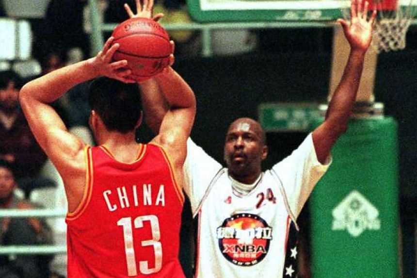 NBA Legends Team star Moses Malone (R) guards China National Team's Sun Jun Jilin during their final game in a four-game series in China in this Oct 23, 1998 photo.