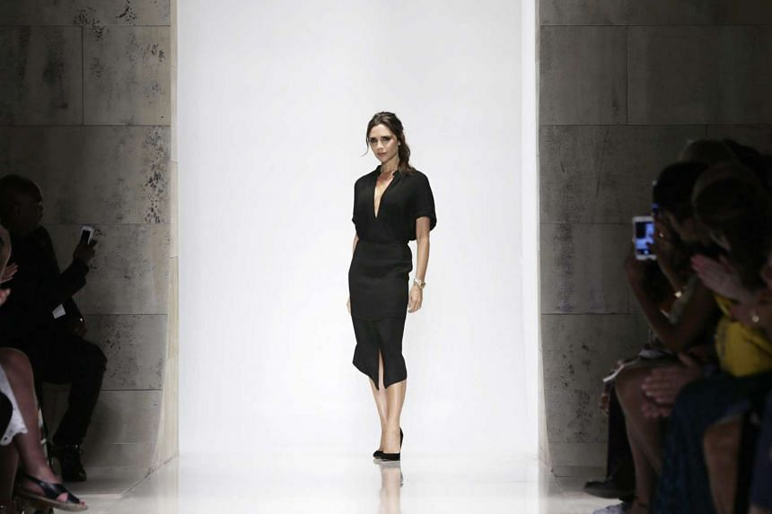 British fashion designer Victoria Beckham greets the crowd after her spring 2016 collection, during New York Fashion Week on Sunday.