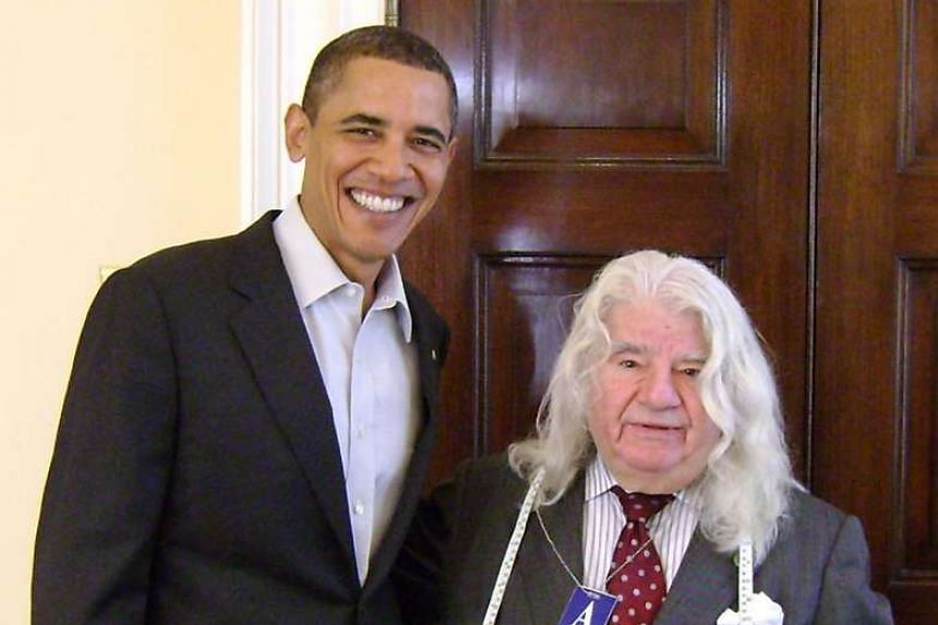 US President Barack Obama with French-born tailor Georges de Paris at the White House in a photo taken in 2014.