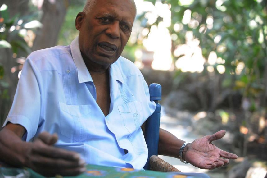 Supreme chief of Haitian voodoo Max Beauvoir speaks during an interview in Port au Prince in 2010.