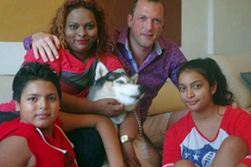 Mr Di Prisco with his wife Kevy, daughter Manita, son Giuseppe and dog Spike.