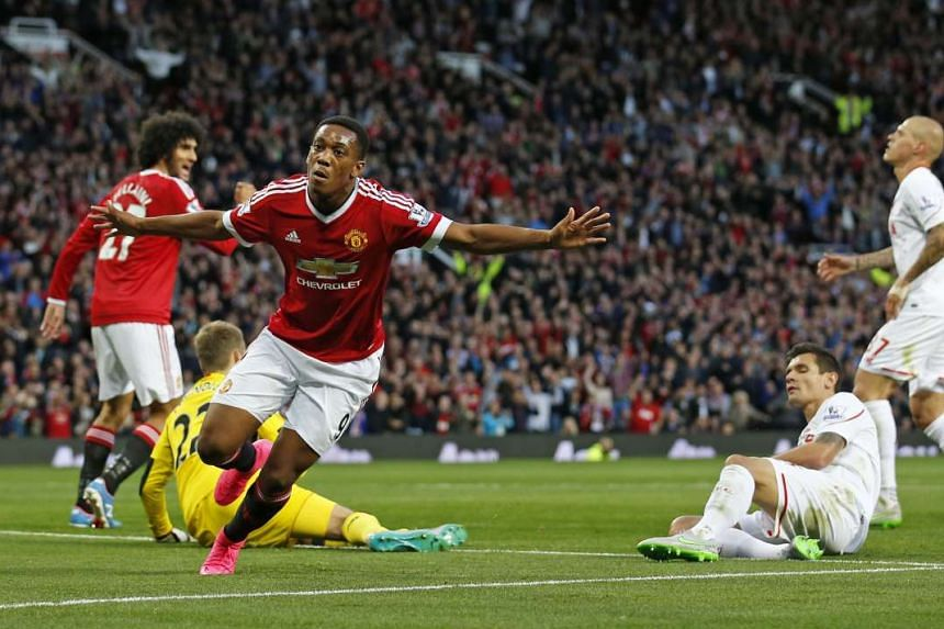 Former Monaco forward Anthony Martial (with arms outstretched), the world's most expensive teenage footballer, justified his huge transfer fee with a memorable solo goal against Liverpool on his debut on Saturday.