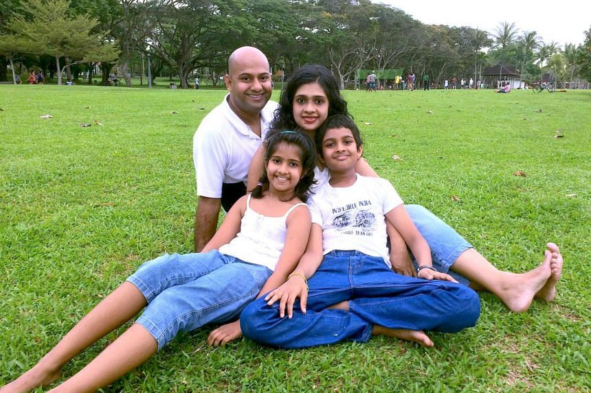Mr Manoj Vasudevan with his wife, Ms Sindu Sreebhavan, son Advaith and daughter Aditi in a family outing at Pasir Ris Park. Mr Vasudevan reached the championship's semi-finals in 2012 and 2013. The third placing on Aug 15 was his first win in the competit